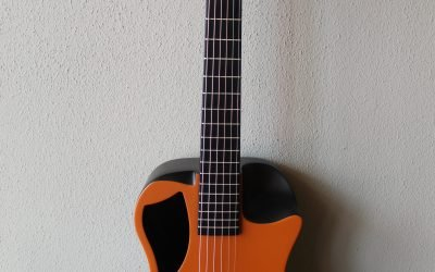 Just added to the store: Journey OF660 Overhead Carbon Fiber Acoustic/Electric Travel Guitar – Orange Matte